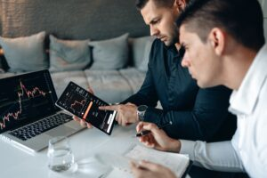 man showing tablet to other man